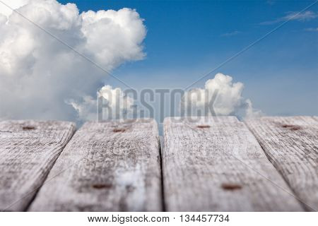 old Boards perspective and blue sky background in distance