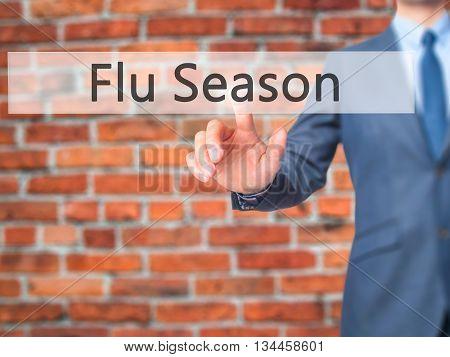 Flu Season - Businessman Hand Pressing Button On Touch Screen Interface.