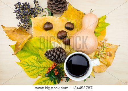 A Bouquet Of Yellow, Green Autumn Leaves And Cup Of Coffee