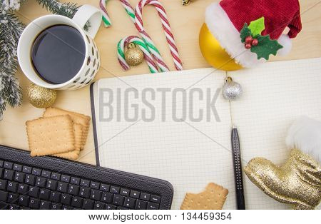 Keyboard,opened Blank Notebook With Cup Of Coffee And Winter Festive Ornaments.