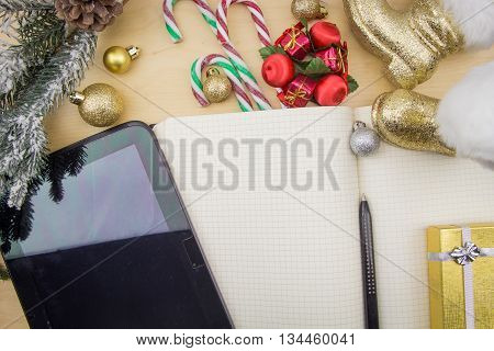 Tablet With Blank Screen, Opened Blank Notebook And Winter Festive Ornaments.