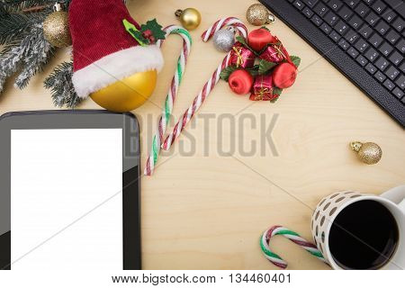 Tablet With Blank Screen, With Cup Of Coffee And Winter Festive Ornaments.