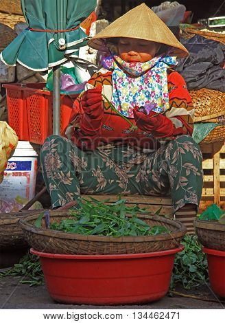 Woman Is Selling Greens On Street Market In Hue, Vietnam