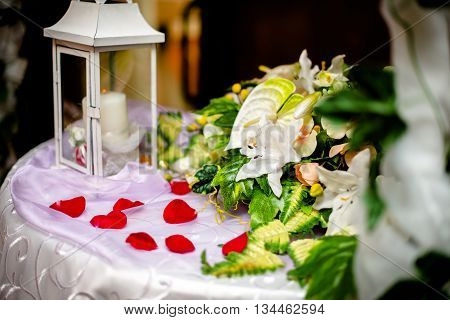 table for gifts at the wedding with rose petals