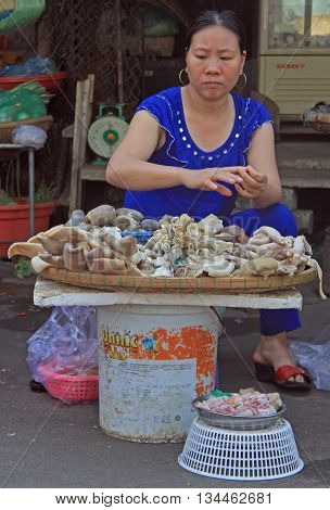 Woman Is Selling Seafood On Street Market In Hue, Vietnam