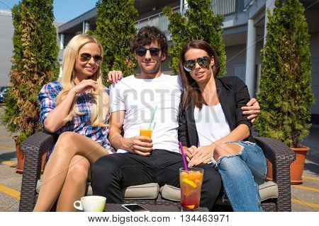 Friends siting on the terrace of a coffee shop