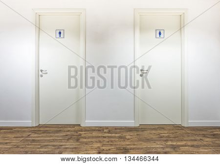 white clean and clear restrooms entrance with wood floor