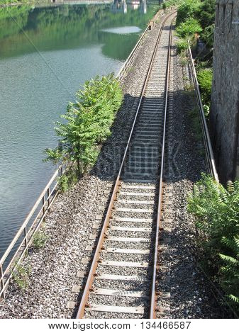 Railway tracks along the river Serchio near Lucca Tuscany Italy