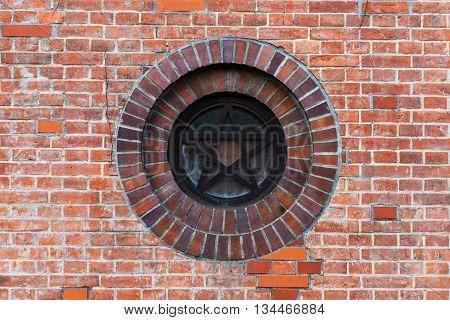 Star sign on red brick wall of Sapporo factory Hokkaido Japan