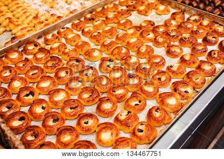 Counter with a variety of pastries and sweets, mini croissants with chocolate in the Mahane Yehuda Market in Erusalem. Israel