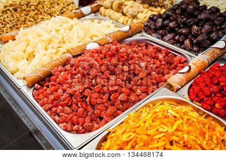 Close-up of different dried fruits in metal boxes. The counter on the Mahane Yehuda Market in Jerusalem, Israel.