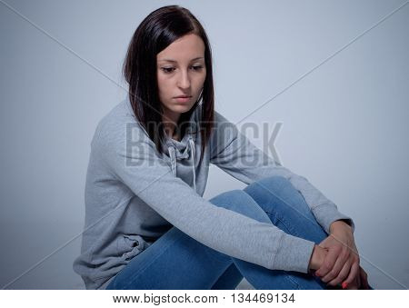 Portrait of sad and depressed young woman