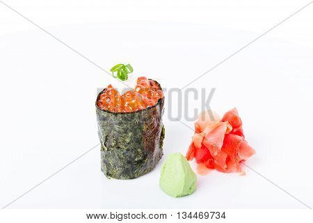 Gunkan sushi stuffed with red salmon caviar and mayonnaise. Served with heap of ginger and wasabi. Macro. Can be used as a whole background.