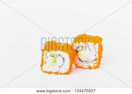 Delicious sushi roll with snow crab and red tobiko caviar. Macro. Photo can be used as a whole background.