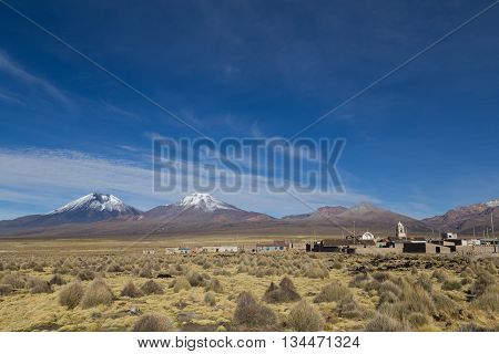 Sajama village with volcanos in the background in Bolivia.