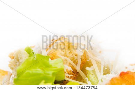 Delicious vegetable salad with croutons and grated cheese. Macro. Photo can be used as a whole background.