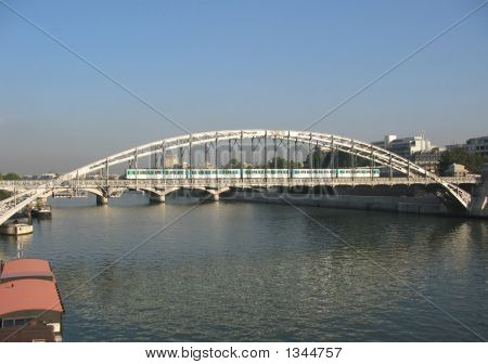 Train Crossing Bridge Over River Seine Paris