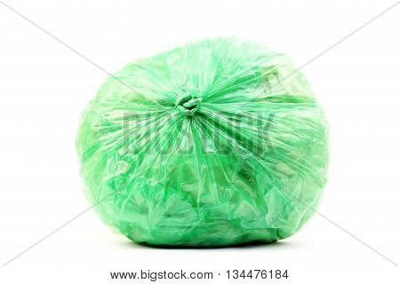 Green rubbish bag isolated on a white background