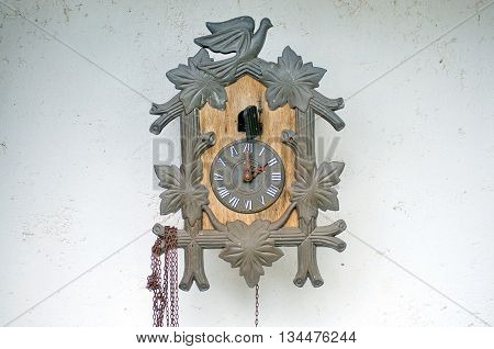 Traditional cuckoo clock hangling on a wall