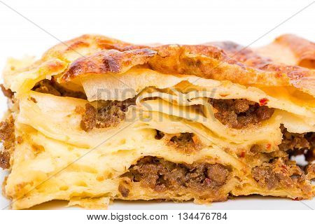 Baked pie with pork forcemeat. Macro. Photo can be used as a whole background.