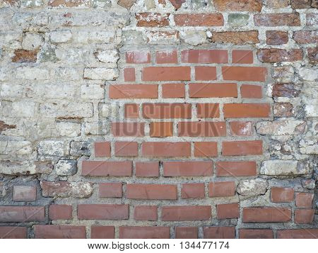 Vintage red bricklaying with plaster wall fragment texture background