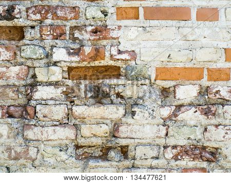 Old vintage red brick wall with sprinkled white plaster texture background