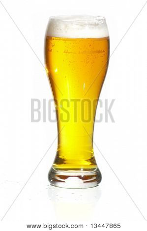 Glass of beer close-up with froth over white background