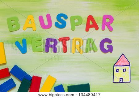 Colorful Letters And A Painted House, German Word, Building Loan Contract