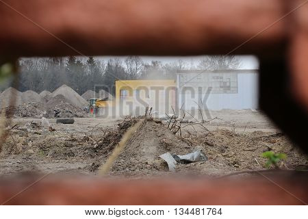 Look Through Hole Onto A Construction Site