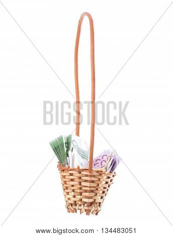 Wicker basket full of euro bills. Isolated on a white background.