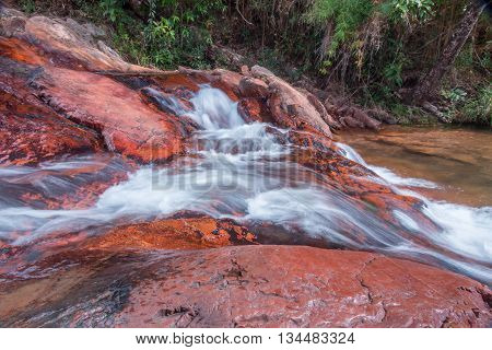 Waterfall in the Interior of Brazil Flowing Over Rocks