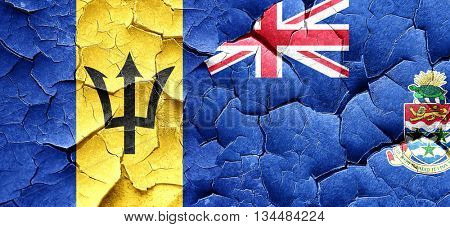Barbados flag with Cayman islands flag on a grunge cracked wall