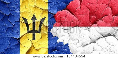 Barbados flag with Indonesia flag on a grunge cracked wall