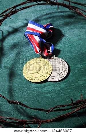 trophy surrounded by the barbwire