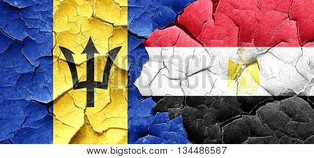 Barbados flag with egypt flag on a grunge cracked wall