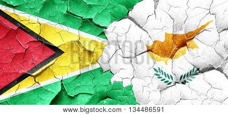 Guyana flag with Cyprus flag on a grunge cracked wall