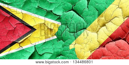 Guyana flag with congo flag on a grunge cracked wall