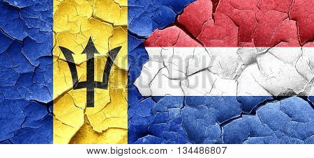 Barbados flag with Netherlands flag on a grunge cracked wall