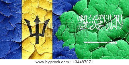 Barbados flag with Saudi Arabia flag on a grunge cracked wall