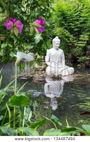 Buddha statue in   garden in Gardone Riviera, Lombardia, Italy
