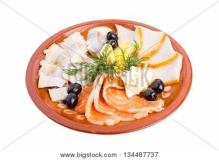 Delicious fish platter. Salmon and smoked sturgeon served with lemon and black olives. Isolated on a white background.