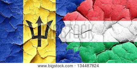 Barbados flag with Hungary flag on a grunge cracked wall
