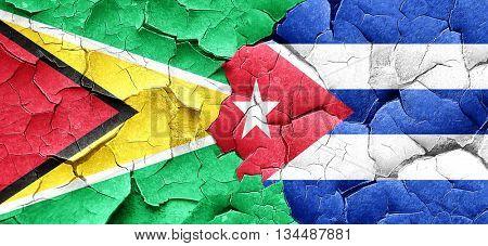 Guyana flag with cuba flag on a grunge cracked wall