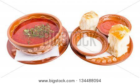Classic ukrainian borscht with sour cream and garlic buns. Isolated on a white background.
