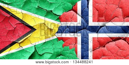 Guyana flag with Norway flag on a grunge cracked wall