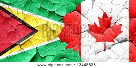 Guyana flag with Canada flag on a grunge cracked wall