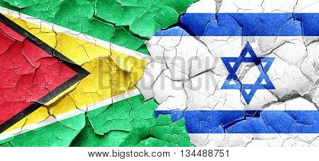 Guyana flag with Israel flag on a grunge cracked wall