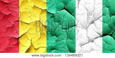 Guinea flag with Nigeria flag on a grunge cracked wall