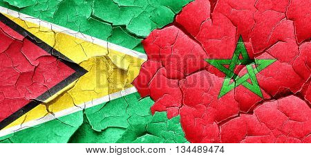 Guyana flag with Morocco flag on a grunge cracked wall