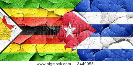 Zimbabwe flag with cuba flag on a grunge cracked wall